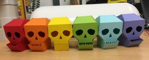 rainbow paper cut skull containers