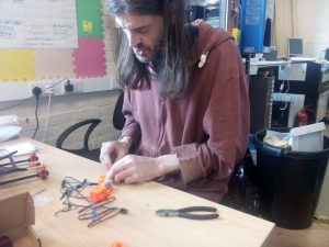 Andy working on the extruder assembly